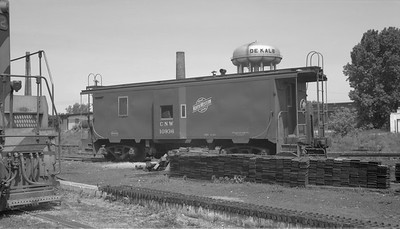 2009.026.12.11306--ritzman 116 neg--C&NW--caboose 10962 off Spring Valley job--DeKalb IL--1962 0902. Idle during C&NW strike starting 8/30/1962.