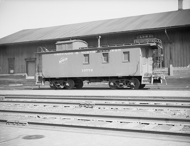 2009.026.12.11303--ritzman 4x5 neg--C&NW--caboose 10772 at freighthouse--DeKalb IL--1946 0414