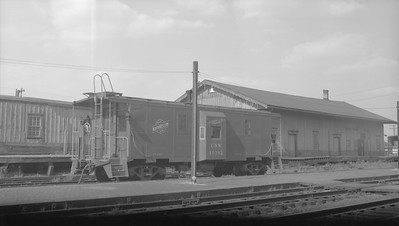 2009.026.12.11298--ritzman 116 neg--C&NW--caboose 10382 at freighthouse--DeKalb IL--1963 0526