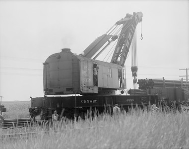 2009.026.17.11483--ritzman 4x5 neg--C&NW--steam wrecker 6359 action at wreck site--Cortland IL--1954 0807. 4:00pm. Wreck happened at 3:30am 8/7/1954.