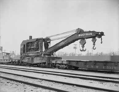 2009.026.17.11476--ritzman 4x5 neg--C&NW--steam wrecker 6151--DeKalb IL--1960 1228. Bucyrus 166, built at South Milwaukee, Wis. 100 ton capacity. From Huron, SD. Sold to Industrial Service and Salvage Co., Joliet, IL. Used tender X263599.