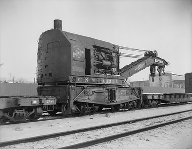 2009.026.17.11475--ritzman 4x5 neg--C&NW--steam wrecker 6151--DeKalb IL--1960 1228. Bucyrus 166, built at South Milwaukee, Wis. 100 ton capacity. From Huron, SD. Sold to Industrial Service and Salvage Co., Joliet, IL. Used tender X263599.
