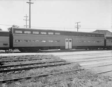 2009.026.13.11339--ritzman 4x5 neg--C&NW--commuter bi-level coach 23 on westbound passenger train 3--DeKalb IL--1958 0921
