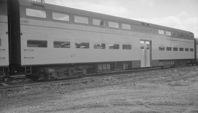 2009.026.13.11338--ritzman 116 neg--C&NW--commuter bi-level coach 23 on westbound passenger train 3--DeKalb IL--1958 0706