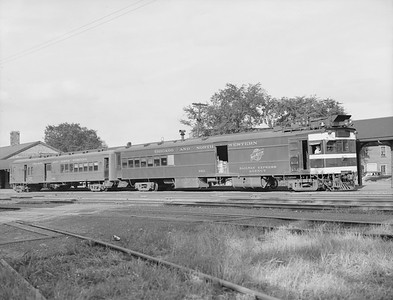 2009.026.07.11288--ritzman 4x5 neg--C&NW--motorcar 9921 and trailer 9903 as Fond du Lac train at depot--Janesville WI--1942 0804