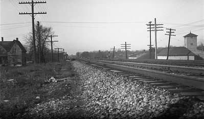 2009.026.19.11660--ritzman 116 negative--C&NW--view--DeKalb IL--1936 1129. Scene along mainline, on curve.