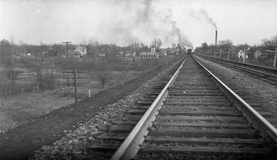 2009.026.19.11658--ritzman 116 negative--C&NW--view--DeKalb IL--1936 1129. Scene along mainline, on curve.