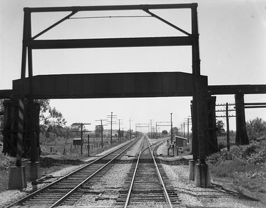 2009.026.19.11644--ritzman 4x5 negative--C&NW--view of overpass--Bluffs IL--1936 0526. Tower taken down Fall 1935, looking west from rear of Train #4, Engine #1562.