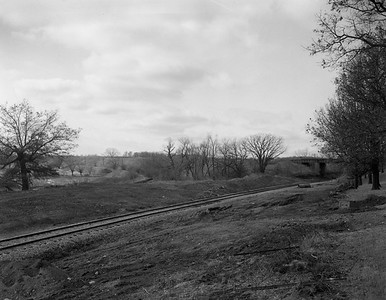 2009.026.19.11641--ritzman 4x5 negative--C&NW MILW--view--Almora IL--1964 0202. Looking southwest across C&NW, old RoW of Milwaukee Road curves away.