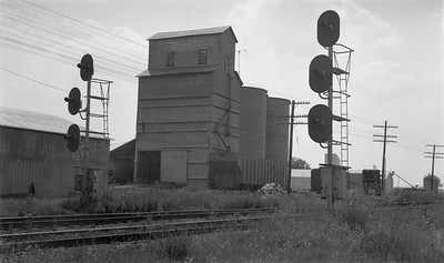 2009.026.19.11654--ritzman 116 negative--C&NW--view--Cortland IL--1969 0818. Looking southwest at elevators and signals, this elevator was moved from Chase, Ill. (Milw. Rd.) about 1951.