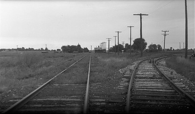 2009.026.19.11643--ritzman 116 negative--C&NW--view--Bain WI--1938 0825. KD Line, looking east on south wye, main track does not go through but turns to north wye, depot ahead in distance.