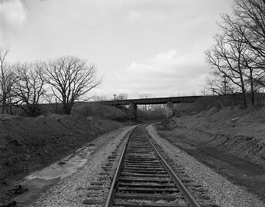 2009.026.19.11636--ritzman 4x5 negative--C&NW MILW--view--Almora IL--1964 0202. Looking west along C&NW under Milwaukee Road main.