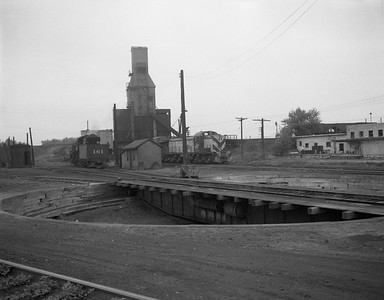 2009.026.19.11655--ritzman 4x5 negative--C&NW--view engine terminal turntable and coal chute--Crystal Lake IL--1951 0517. Looking north, R-1 #161, Alco Rd. Sw. #1516