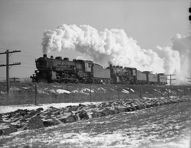 2009.026.01.10686--ritzman 4x5 neg--C&NW--steam locomotive 2-8-2 J-S 2461 and 2425 westbound caboose hop extra action--west of DeKalb IL--1943 0208