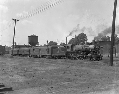 2009.026.01.10436--ritzman 4x5 negative--C&NW--steam locomotive 4-4-2 D 1089 on passenger train--Freeport IL--1937 0805
