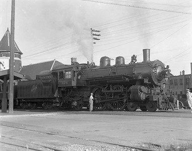 2009.026.01.10208--ritzman 4x5 negative--C&NW--steam locomotive 4-4-2 D 126 westbound on passenger train 25--DeKalb IL--1938 0723. 5:20pm.