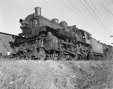 2009.026.01.10964--ritzman 4x5 neg--C&NW--steam locomotive 4-4-2 D 395 (retired) at NWS&W for scrapping--Sterling IL--1954 1223
