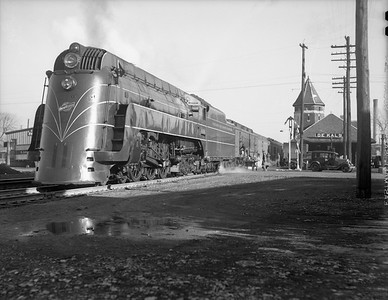 2009.026.01.10927--ritzman 4x5 neg--C&NW--steam locomotive 4-6-4 E-4 4006 on 1st section westbound passenger train 21--DeKalb IL--1940 1221. At depot with 14 cars.