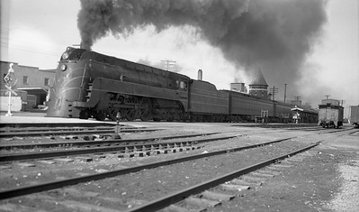 2009.026.01.10915--ritzman 116 neg--C&NW--steam locomotive 4-6-4 E-4 4003 on eastbound passenger train Overland Limited 24-car action--DeKalb IL--1946 0511. Eastbound with 24 cars.