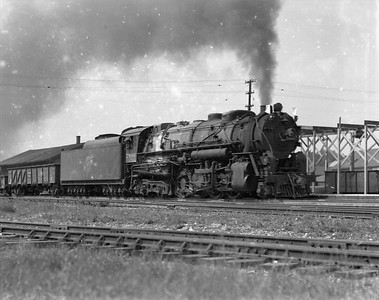 2009.026.01.10772--ritzman 4x5 negative--C&NW--steam locomotive 2-8-4 J-4 2806 on freight train action--DeKalb IL--1946 0914