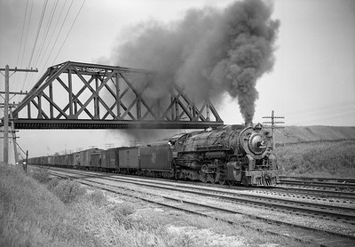 2009.026.01.13087--ritzman 5x7 negative--C&NW--steam locomotive 2-8-4 J-4 2801 on freight train action--east of DeKalb IL--1944 0530. MILW overpass, eastbound.