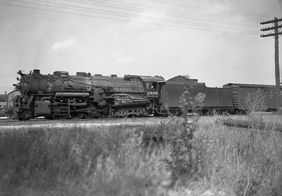 2009.026.01.13090--ritzman 5x7 negative--C&NW--steam locomotive 2-8-4 J-4 2808 on freight train--DeKalb IL--1943 0820. Westbound east of 7th Street.