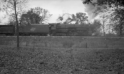 2009.026.01.13086--ritzman PC negative--C&NW--steam locomotive 2-8-4 J-4 2801 on freight train action--west of DeKalb IL--1937 1018. Engine cut off to go to coal dock.