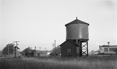 2009.026.15.11829--ritzman 116 negative--C&NW--water tank and depot--Ashippun WI--1948 0904. Looking southwest, 7:30am.