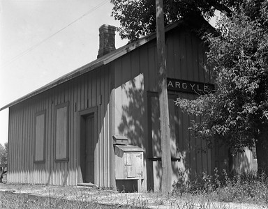 2009.026.15.11826--ritzman 4x5 negative--C&NW--depot--Argyle IL--1936 0612. Looking east, KD Line. Main track on north side of depot.