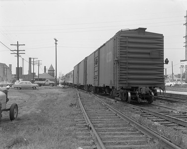 2009.026.14.12606--ritzman 4x5 negative--CStPM&O--mail storage boxcar 20026 on train 3--DeKalb IL--1957 0900. Westbound on train #3.