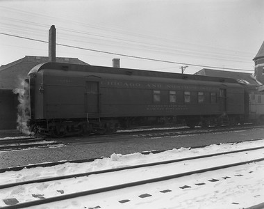 2009.026.14.12598--ritzman 4x5 negative--CStPM&O--RPO car 317--DeKalb IL--1960 0125. Westbound on train #3.