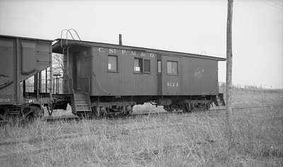 2009.026.11.14149--ritzman PC negative--CStPM&O--caboose 6124--Buda IL--1960 0420. Used in clearing up wreck of some months earlier. Also used later in establishing wye at buda Jct., see neg of 5/1961. FRR