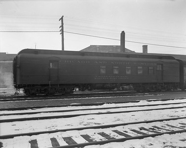 2009.026.14.12597--ritzman 4x5 negative--CStPM&O--RPO car 317--DeKalb IL--1960 0125. Westbound on train #3.