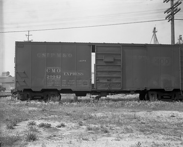 2009.026.14.12606 1--ritzman 4x5 negative--CStPM&O--express boxcar 20042--DeKalb IL--1960 0711. Arrived on the rear of train #3.