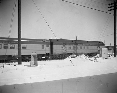 2009.026.14.12599--ritzman 4x5 negative--CStPM&O--RPO car 322--DeKalb IL--1960 0307. On rear of westbound train #3, noon.