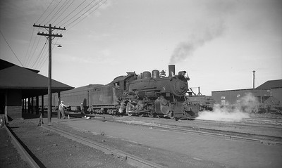 2009.026.03.14135--ritzman PC negative--CStPM&O--steam locomotive 4-6-0 K-1 112 on passenger train at depot--Spooner WI--1947 0824