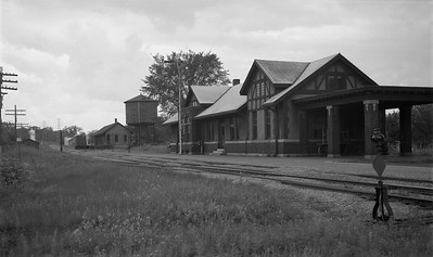 2009.026.16.12615--ritzman 116 negative--CStPM&O--depot--Chippewa Falls WI--1951 0809. Looking west.