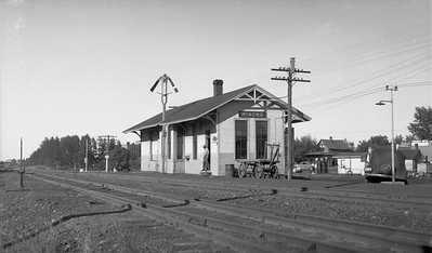 2009.026.16.12633--ritzman 116 negative--CStPM&O--depot--Minong WI--1947 0824. Looking northeast.