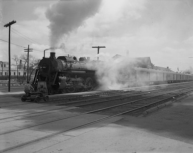 2009.026.01.14316--ritzman 4x5 negative--ICRR--steam locomotive 4-6-2 1178 on passenger train--Freeport IL--1950 0414