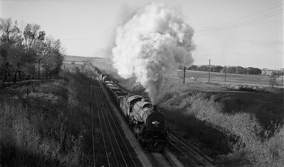 2009.026.01.14323--ritzman 116 negative--ICRR--steam locomotive 2-8-2 2134 action on freight train--Amboy IL--1948 1017