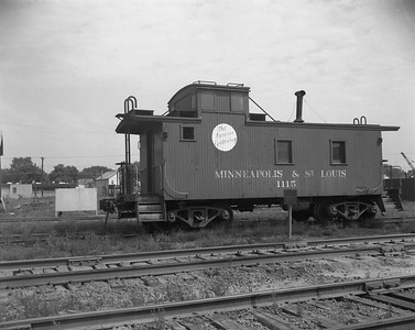 2009.026.12.14392--ritzman 4x5 negative--M&StL--caboose 1115--DeKalb IL--1961 0827. In use on Spring Valley line since 7/20/1961.