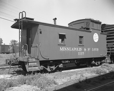 2009.026.12.14391--ritzman 4x5 negative--M&StL--caboose 1115--DeKalb IL--1961 0725. In use on Spring Valley line since 7/20/1961.