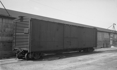 2009.026.12.14286--ritzman 116 negative--D&RGW--boxcar 61346--DeKalb IL--1945 0428. At Interstate Aircraft & Engineering plant.