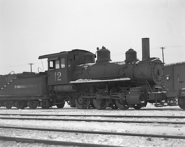 2009.026.01.14438--ritzman 4x5 negative--South Omaha Terminal Rwy Co--steam locomotive 0-6-0 12--DeKalb IL--1947 0107. Baldwin #23880, built 3/1904, on eastbound wayfreight 2:00pm.