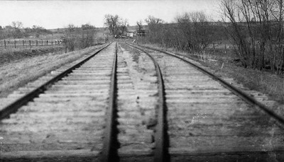2009.026.2.35.003--ritzman print--C&NW--view of tracks and siding looking west on New Diggings spur--one mile west of New Diggings--1934 0429