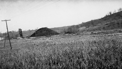 2009.026.2.35.011--ritzman print--C&NW--view of abandoned mine and tailings pile looking east--one mile west of New Diggings WI--1934 0429