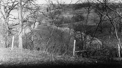 2009.026.2.35.008--ritzman print--C&NW--view looking northeast at New Diggings spur track from bluff over tunnel--near New Diggings WI--1934 0429
