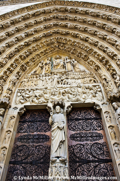 Souls carved in stone on Cathedral of Notre Dame.