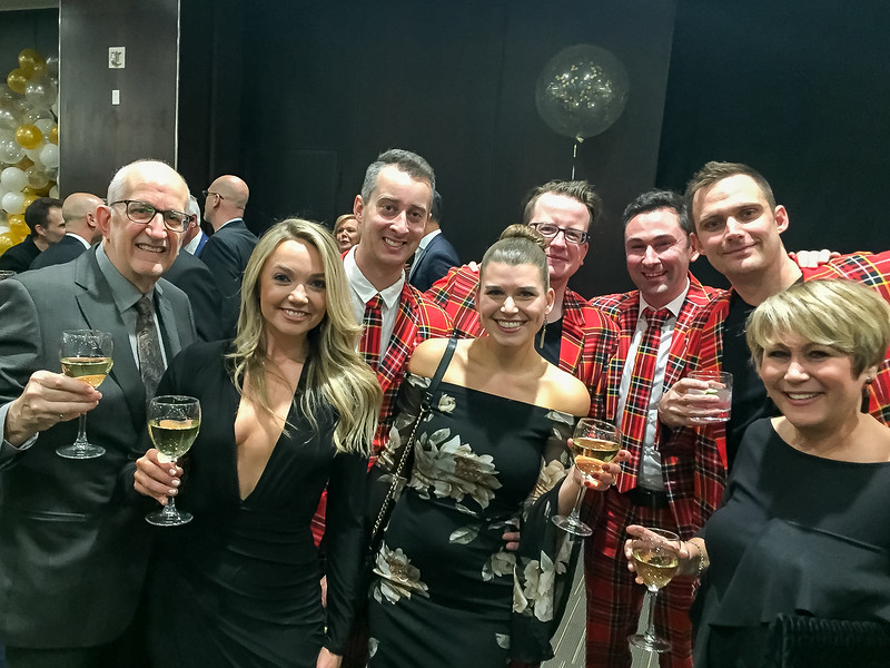 The Stevenson Streich Team toasting with the Alun Evans Team behind (from Oakville)