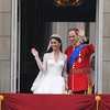Britain's Prince William and his wife Kate, Duchess of Cambridge wave from the balcony of Buckingham Palace after the Royal Wedding in London Friday, April, 29, 2011.